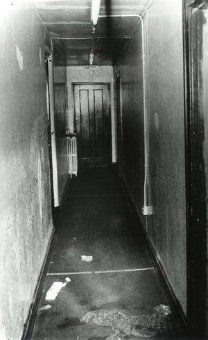 Hallway of the Corryville apartment building where Cincinnati police Officer Bruce Hoffbauer shot Walter Brown on Dec. 28, 1990, after Hoffbauer said Brown charged at him in the 3-foot-wide hallway. Brown's door is at near right.