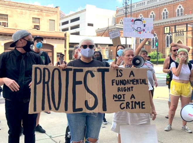 People rallied outside Cincinnati City Hall Tuesday after lawyers representing protesters filed motions to have the charges dropped for the more than 500 people arrested during demonstrations in late May and early June.