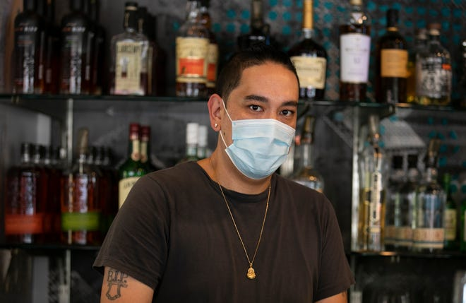 Danny Yant, left, owner of Quan Hapa in Over-the-Rhine, works behind the bar Tuesday, July 7, 2020. Yant, along with fellow-owner, Duy Nguyen and Mapi De Veyra, chef, were gearing up for the new mask ordinance for the city of Cincinnati beginning July 9.