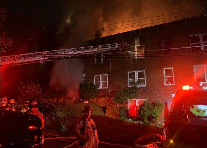 Cincinnati fire crews are battling a three-alarm fire at a vacant Walnut Hills building early Tuesday