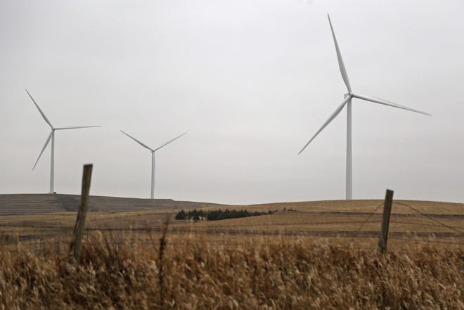 Wind turbines spin in the breeze outside of Ida Grove in northwest Iowa.