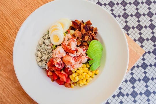 The lobster Cobb salad at Hazel's in Birmingham has lobster meat, tomatoes, egg, blue cheese crumbles, bacon, avocado and corn.
