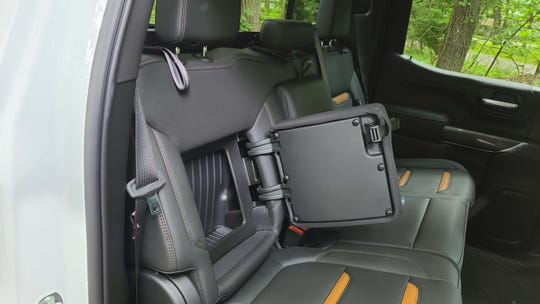 The 2020 GMC Sierra AT4 features hidden storage for clothes or a laptop behind the rear seats.