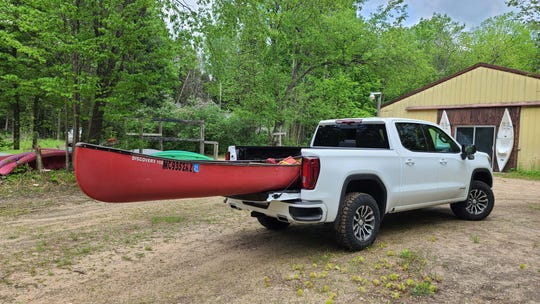 Have bed, will travel. The 2020 GMC Sierra AT4 came in handy when Detroit News auto critic Henry Payne needed to transport canoes in East Jordan, Michigan.