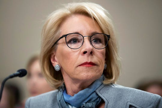 In this Feb. 27, 2020, file photo, Education Secretary Betsy DeVos pauses as she testifies during a hearing of a House Appropriations Sub-Committee on the fiscal year 2021 budget on Capitol Hill in Washington.