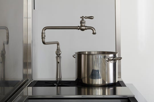 Deck-mounted pot fillers can be mounted directly to the countertop next to the stovetop.