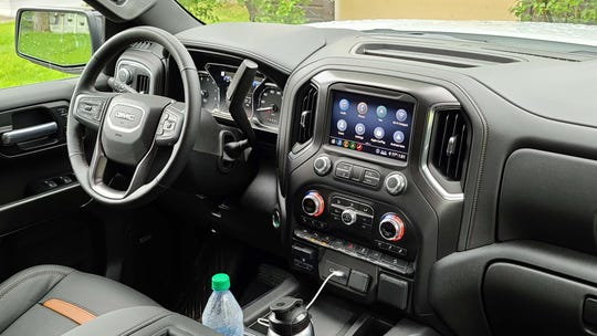 The interior of the 2020 GMC Sierra AT4 is comfortable and ergonomically useful — but it lags competitors like the Ram 1500.