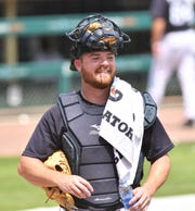 Tigers catcher Jake Rogers takes a drink of water after live batting practice on Tuesday.