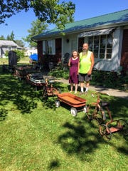 Karen Daniels and Dave Skiver view just a small section of their display of vintage tricycles and wagons.