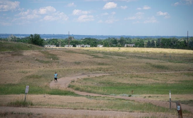 "A runner uses the trail at Maxwell Natural Area near the Hughes Stadium site in Fort Collins, Colo. on Monday, July 6, 2020. The land remains in placeholder ""transition"" zoning after council deadlocked on its final rezoning vote last month."