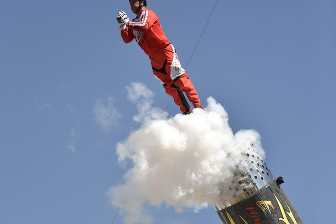 """Human cannonball David """"The Bullet"""" Smith blasts off last month in Sarasota during Nik Wallenda's Daredevil Rally Drive-In Thrill Show."""