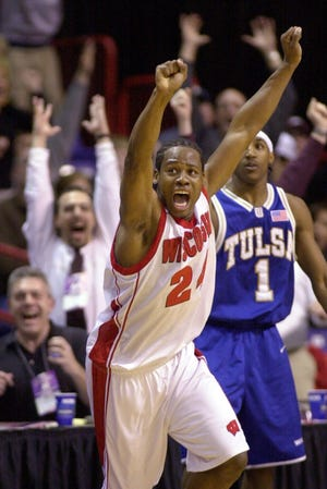 Freddie Owens turns and cheers after making a 3-point, go-ahead shot with one second remaining against Tulsa in the second round of the NCAA tournament in 2003.