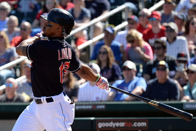 Cleveland Indians shortstop Francisco Lindor hits a home run in a game against the Chicago Cubs in March before spring training was shut down by the coronavirus.