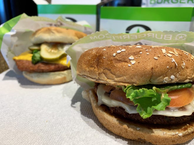 "Foreground: The ""VegeFi"" burger; background: the Beyond burger from BurgerFi, South Naples."