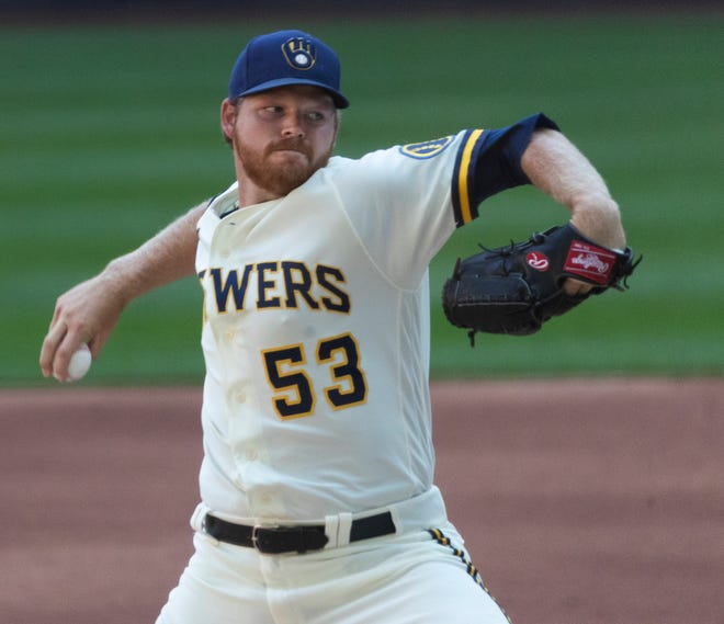 Brewers pitcher Brandon Woodruff fires toward the plate.