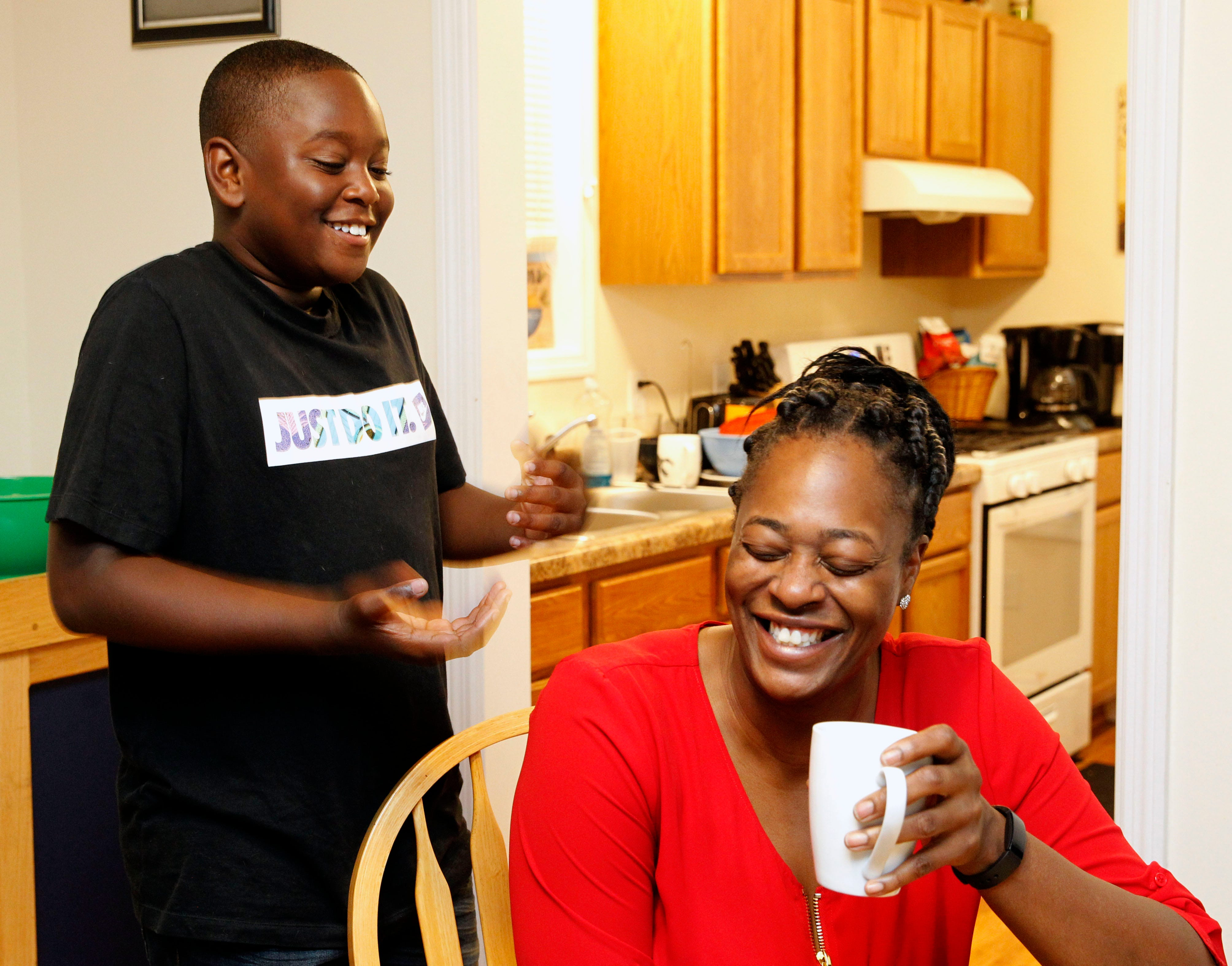 Matthias Jeffrie enjoys a moment with his mother LaVera Jeffrie at their St. Paul home on Sept. 30.  Jeffrie and her son have been in their Habitat for Humanity home since 2017. She and Matthias collaborated on how to decorate it.