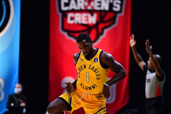The Golden Eagles' Darius Johnson-Odom is fired up after scoring in The Basketball Tournament on Monday.