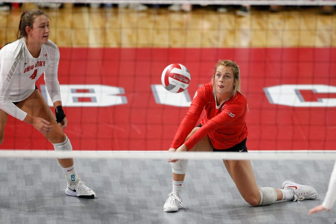Former Yorktown player and Ohio State women's volleyball defensive specialist Kylie Murr digs a ball against Northwestern Friday, Nov. 22, 2019, in Columbus, Ohio.
