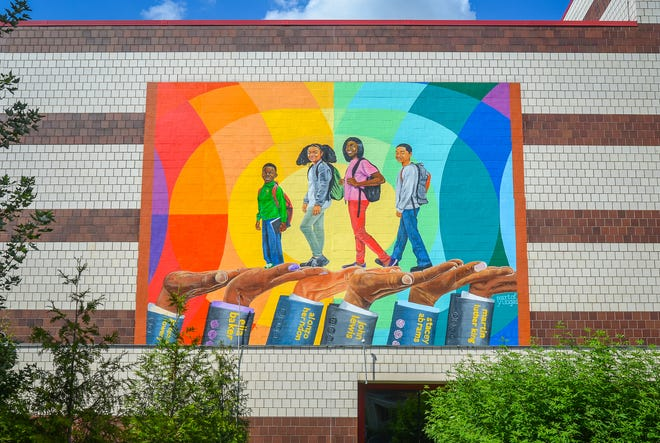 "Muhammad Yungai's mural ""Helping Hands"" is on the Woodruff Library in Atlanta."