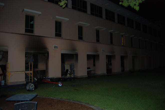 Fire damage is shown outside O'Donnell Hall on the New Mexico State University main campus Monday, July 6.