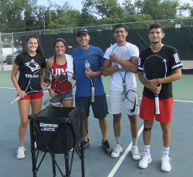 The Fulgenzi family poses during the July 4 weekend Cavern City Adult Tennis Tournament. Left to right: Brandy Fulgenzi, Lauren Fulgenzi, Warren Fulgenzi Sr., Nico Fulgenzi and Warren Fulgenzi II. The Fulgenzi family won five of the eight championships in the tournament.