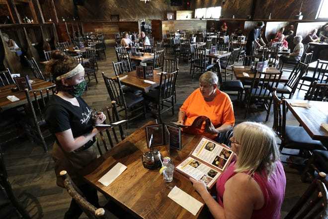 Employee Stephanie Blue takes a lunch order Tuesday, July 7, 2020, from James and Janice Yager of Oshkosh at The Mineshaft Restaurant, 2041 S. Koeller St., Oshkosh.