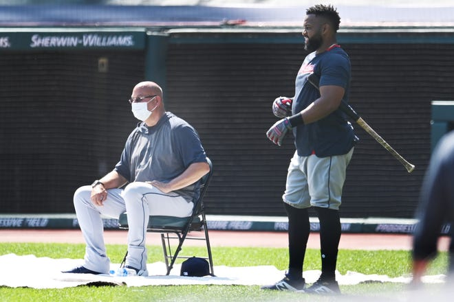 Cleveland manager Terry Francona wears a mask with the coronavirus in mind as he and Carlos Santana watch batting practice Monday.