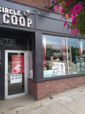A rock sits at the bottom of a smashed window Tuesday morning downtown at the Full Circle Book Co-op in Sioux Falls. Police are investigating the situation as possible vandalism.