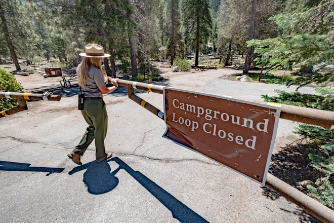 Park Ranger Summer Elcock opens the gates to Lodgepole campgrounds in Sequoia National Park on Monday, July 6, 2020. Spaces in Lodgepole, Potwisha and Sunset campgrounds are limited and available by reservation only for the rest of this year. Visitors can pay entrance fees or purchase a pass online before arriving.
