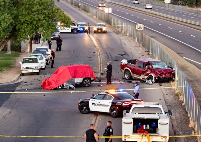 CHP and Visalia Police investigate a deadly head-on collision on Mineral King Avenue at Crumal Street on Monday, July 6, 2020. The truck left westbound Highway 198 through chain-link fence about a half-mile before striking the eastbound car. Both occupants of the car died at the scene, the driver of the truck was transported to a local hospital.