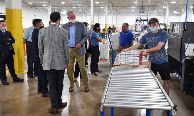 Officials with Pamlico Air gave community leaders a tour of the new air filter manufacturing facility in this file photo. A report shows the Wichita Falls area lost 3,700 manufacturing jobs in the past 20 years. In recent years, however, new manufacturing businesses have come to the city with promise of a resurgence of growth for the area.