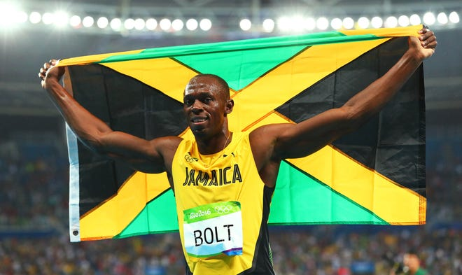 Usain Bolt celebrates winning the gold medal in the men's 200m in the Rio 2016 Summer Olympic Games.