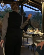 Screenshot of waitress asking Lofthouse to leave restaurant.