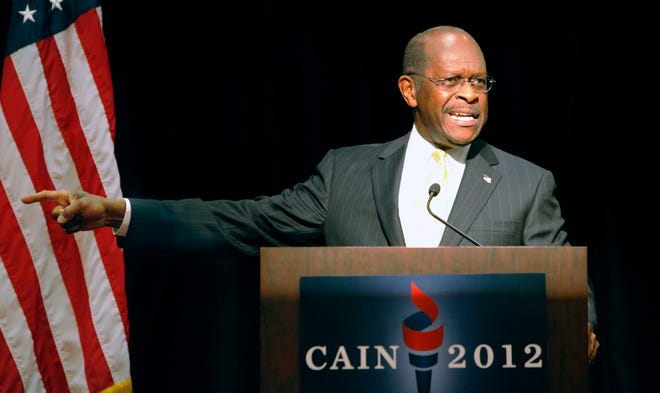 Former Republican presidential candidate Herman Cain speaks during his first stop of an Ohio bus tour at the Cincinnati Marriott North in West Chester, Ohio, Wednesday, Nov. 30, 2011.