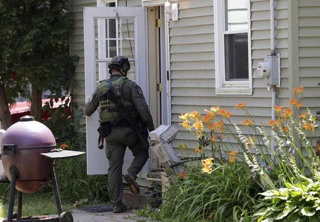 Officials investigate a home located at 1038 W. Spring Street Wednesday, July 8, 2020, in Appleton, Wis.  Dan Powers/USA TODAY NETWORK-Wisconsin