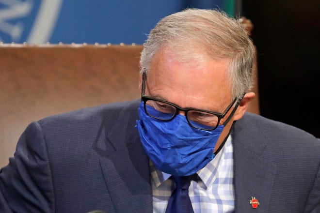 Washington Gov. Jay Inslee wears a face mask as he concludes a news conference on June 23 at the Capitol in Olympia.