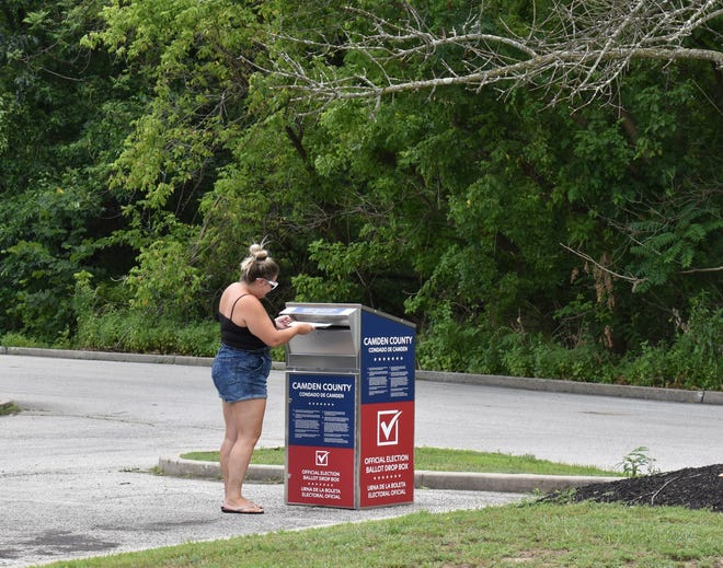 A woman casts her ballot Tuesday at a Camden County elections drop box in Cherry Hill.
