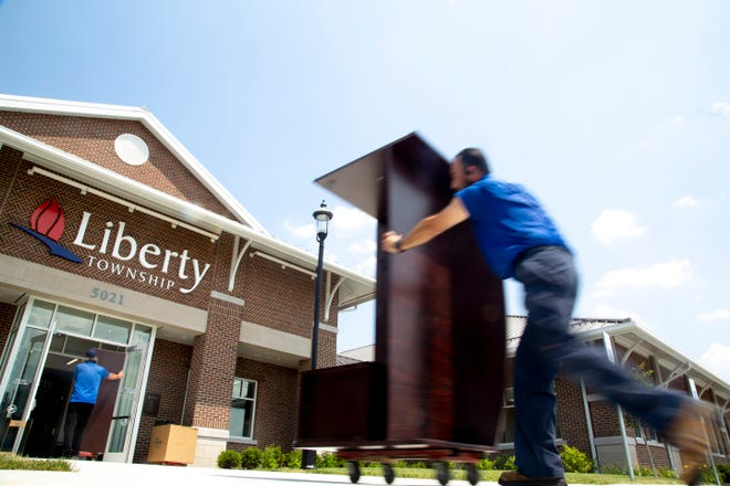 Norman Sosa moves furniture into Liberty Township's new administration building on Wednesday, July 8, 2020.