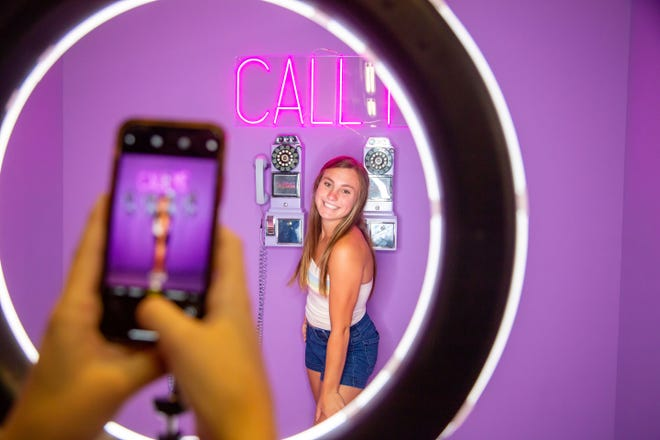 Natalie Lewis,16, poses for photos at the Selfie Station at the Merle Hay Mall Wednesday, July 8, 2020.