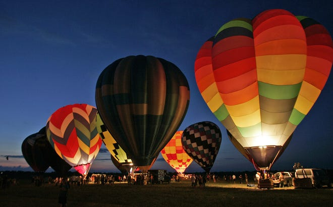Hot air balloons light up during the nite-glo  at the 2007 National Balloon Classic in Indianola  Friday night , July 27th.