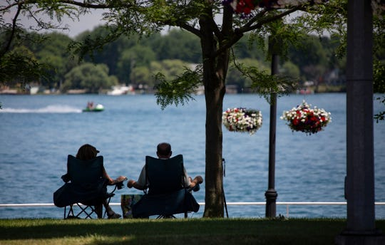 A couple keeps watch on the St. Clair River from Palmer Park in St. Clair.