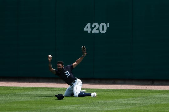 Detroit Tigers outfielder Derek Hill catches a fly ball in the center field during an intrasquad game at summer camp at Comerica Park in Detroit, Wednesday, July 8, 2020.
