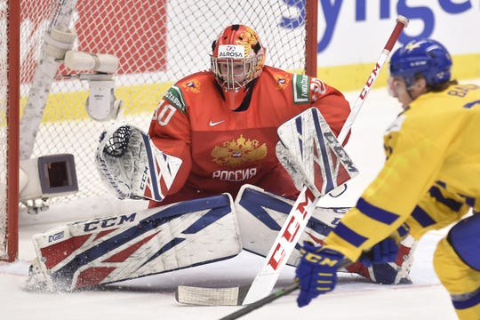 From left, goalie Yaroslav Askarov of Russia and Oskar Back of Sweden in action during the 2020 IIHF World Junior Ice Hockey Championships semifinal match between Sweden and Russia in Ostrava, Czech Republic, on Jan. 4, 2020.