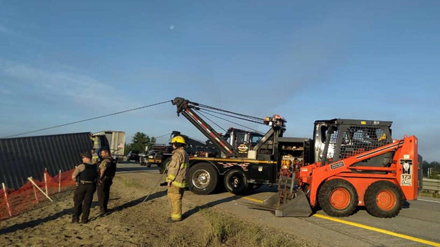 Cows on the loose close I-75 in northern Michigan after livestock rig overturns