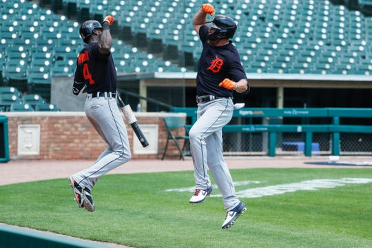 Detroit Tigers outfielder JaCoby Jones, right, celebrates his home run with Cameron Maybin during an intrasquad game at training camp at Comerica Park in Detroit, Wednesday, July 8, 2020.