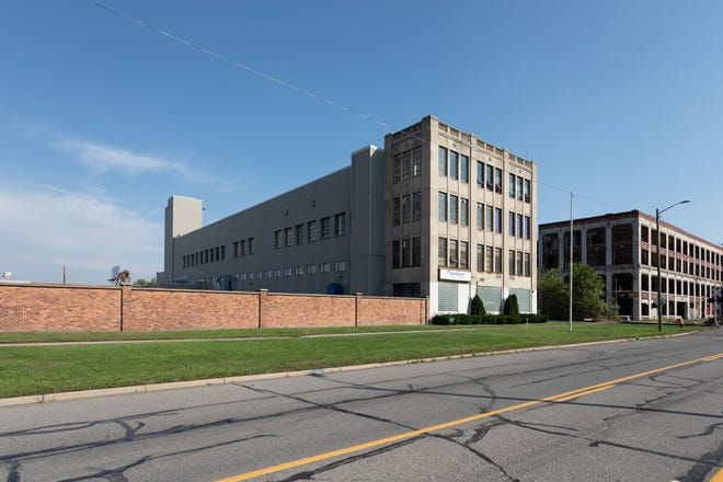 An office  building and warehouse in the area of the former Packard Plant are for sale.