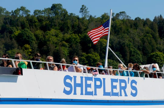 A Shepler's ferry heads towards the dock near Main Street in downtown Mackinac Island, Michigan on July 1, 2020.