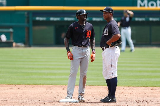 Detroit Tigers outfielder Cameron Maybin talks to second baseman Jonathan Schoop during an intrasquad game at summer camp at Comerica Park in Detroit, Wednesday, July 8, 2020.