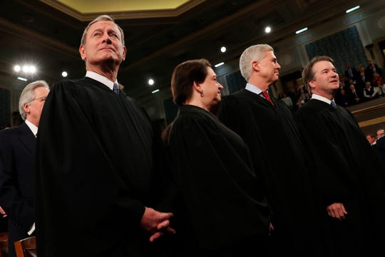 From left, Supreme Court Chief Justice John Roberts, Associate Justice Elena Kagan, Associate Justice Neil Gorsuch and Associate Justice Brett Kavanaugh, before President Donald Trump delivers his State of the Union address to a joint session of Congress in the House Chamber on Capitol Hill in Washington, Tuesday, Feb. 4, 2020.