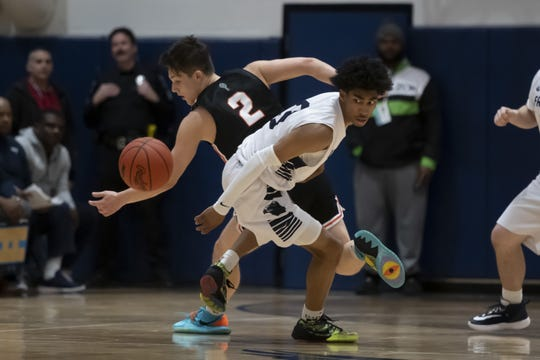Farmington guard Jaden Akins (in white) could be Michigan State's next top recruiting target.